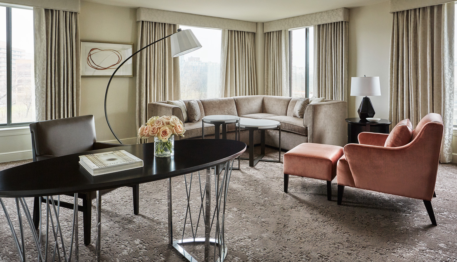 Desk and sitting area in guestroom at the Four Seasons hotel