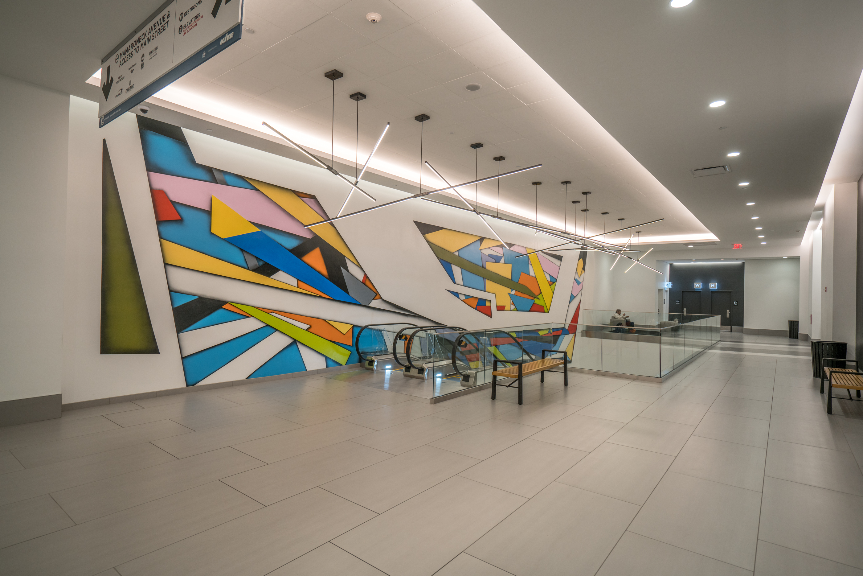City Center escalator and wall mural
