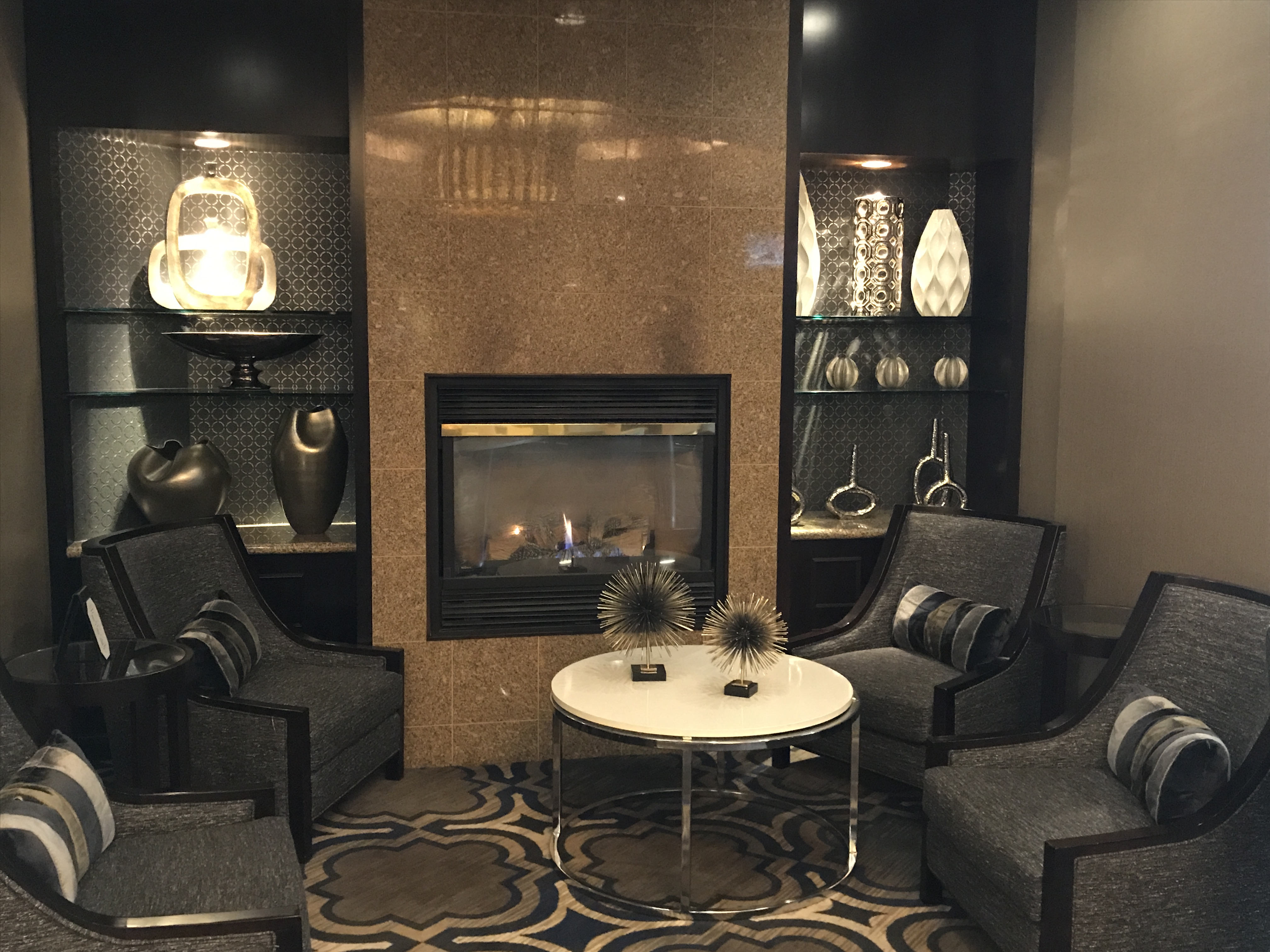 Annapolis Crowne Plaza guest sitting area by a fireplace