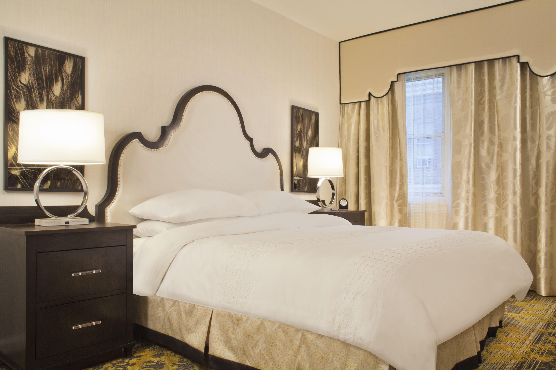 Churchill Hotel king bed guestroom