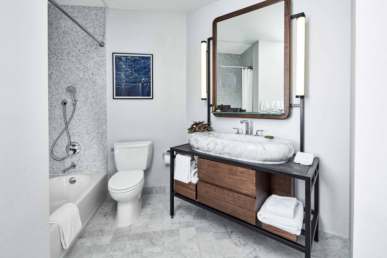 The James New York bedroom suite bathroom