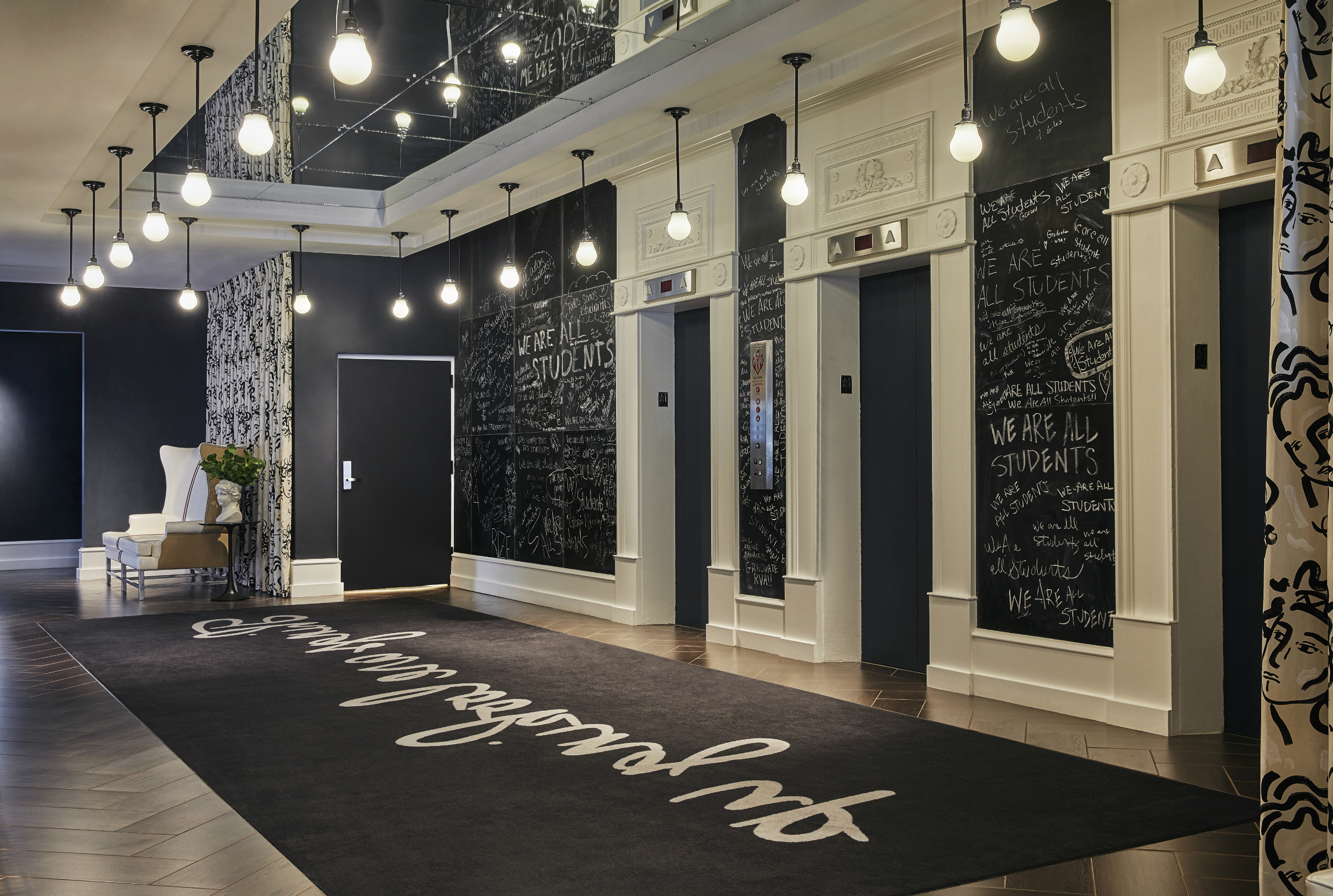 Graduate Richmond Hotel renovated corridor with chalkboard painted walls