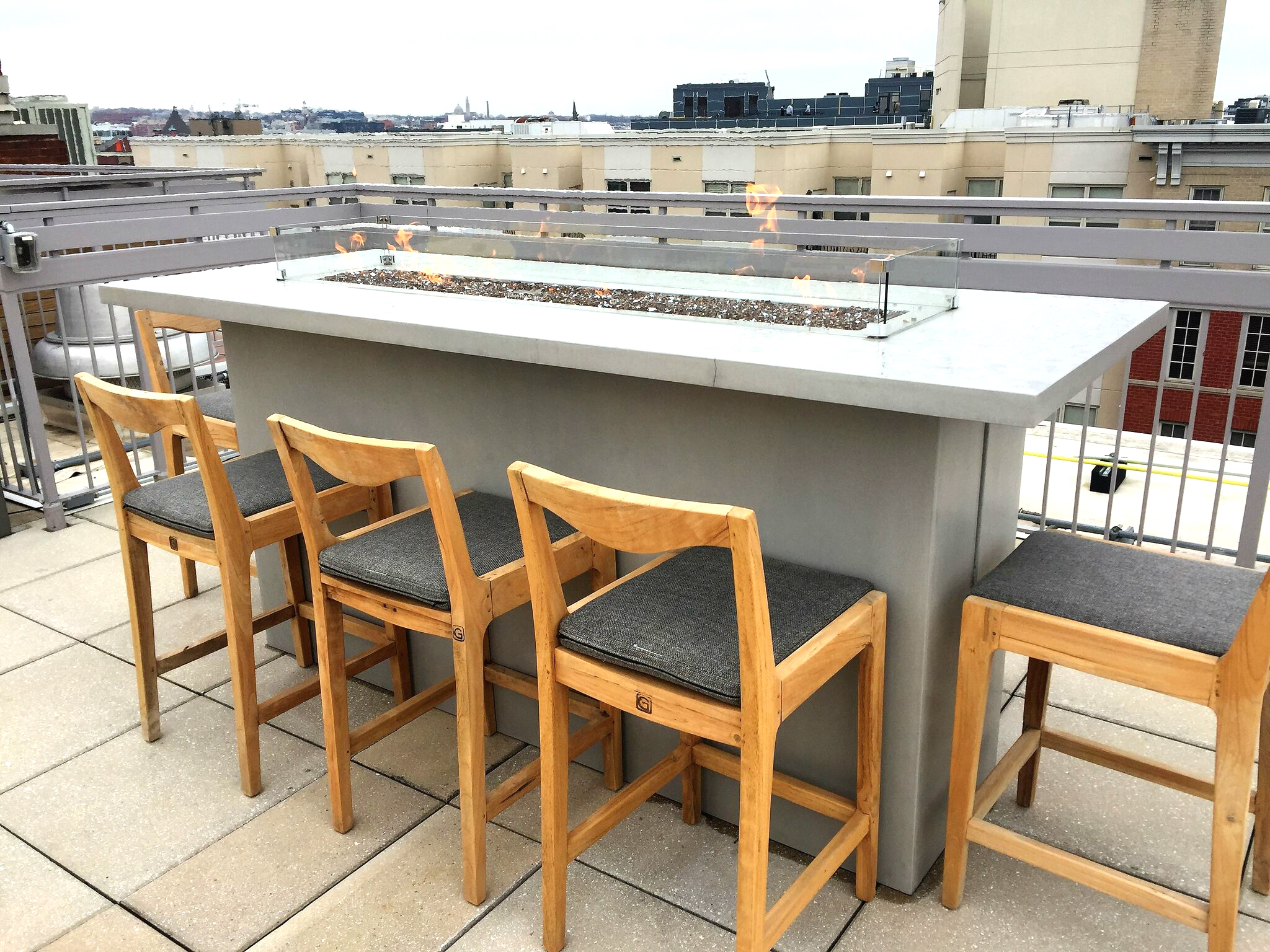 Rooftop fire pit at The Latrobe Apartment Homes
