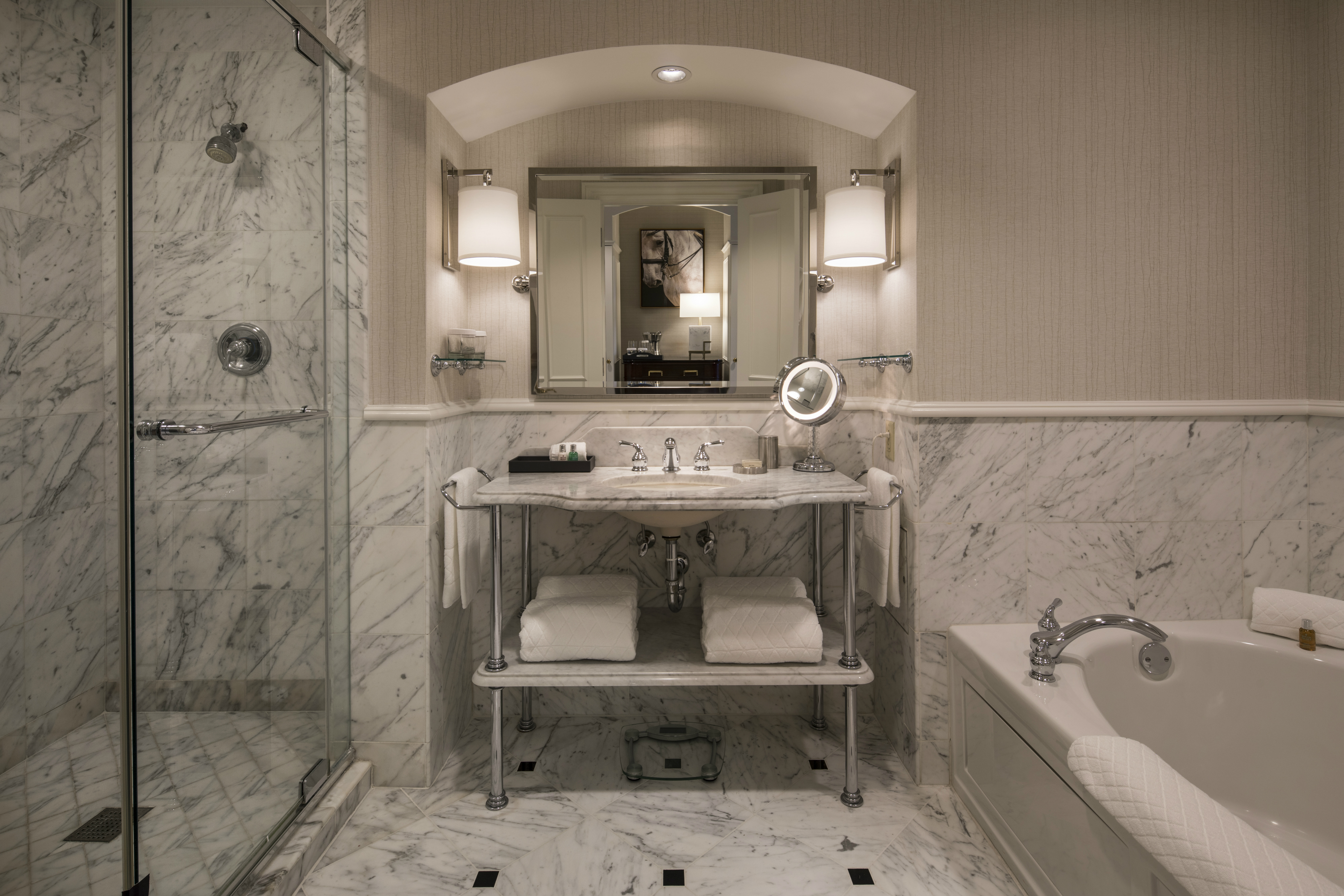 Renovated marble guest bathroom at The Ballantyne Hotel
