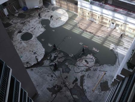 Slab repair and re-leveling of Embassy Suites atrium